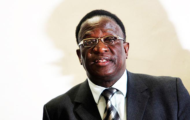 Mnangagwa smiling after Mugabe's cabinet reshuffle