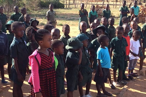 In Zimbabwe, a 6 eary girl stands up to the challenge of cheering up the kids