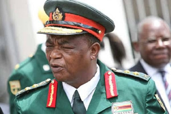 Mugabe mends fances with army, invites them to bash